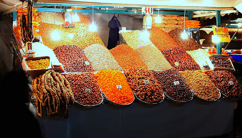 A Fruit & Nut Stall in Marrakech, Morocco. Photo: austinevan, used under Creative Commons License (By 2.0)