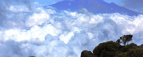 View of Mt. Meru from Mt. Kilimanjaro, Tanzania  Photo: malcyzk, used under Creative Commons License (By 2.0)