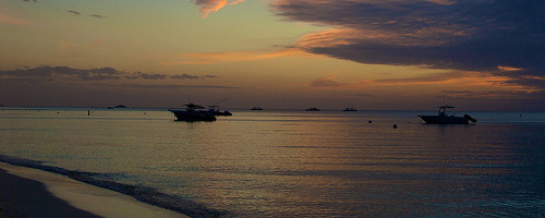 Sunset at Seven Mile Beach, Grand Cayman, Cayman Islands - Photo:pmarkham, used under Creative Commons License (By 2.0)
