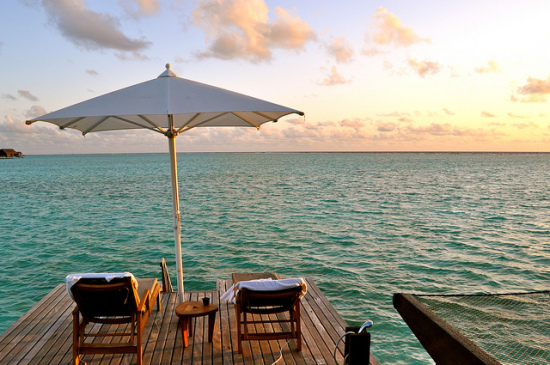 Sunset, The One & Only Resort Reethi Rah, Maldives - Photo: Sarah_Ackerman via Flickr, used under Creative Commons License (By 2.0)