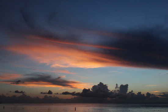 Sunset, Grand Cayman, Cayman Islands - Photo: KatieThebeau via Flickr, used under Creative Commons License (By 2.0)