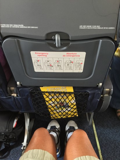 "By comparison, I had seemingly limitless legroom in the exit row, but the seat ""cushion"" was thin, sank about two inches when I sat down, and my seat did not recline. - Photo: real_jetsetr"
