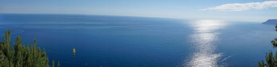 Panoramic view from high above the sea, nearing Riomaggiore., Cinque Terre, Italy.- Photo: (c) Adam Smith